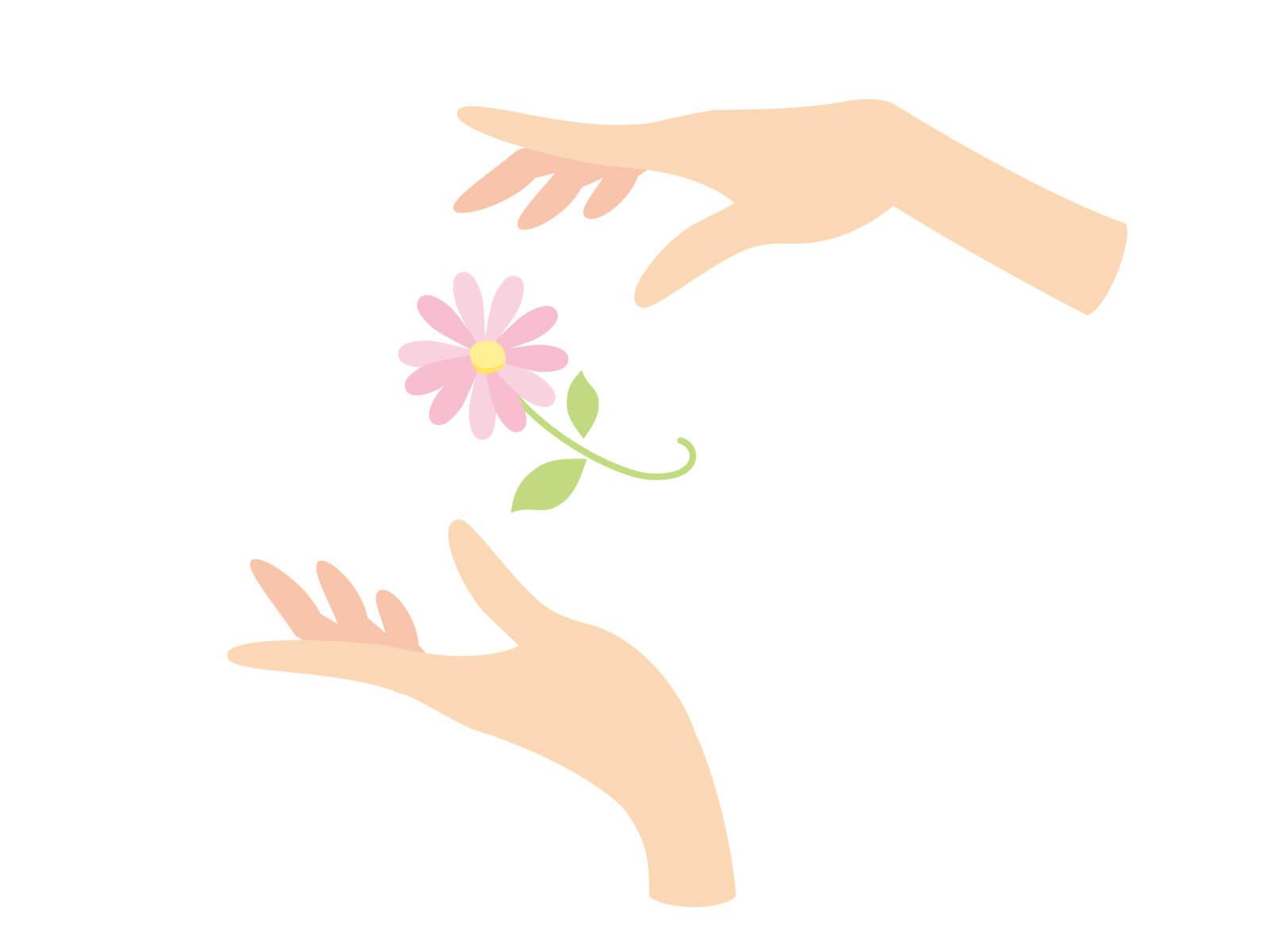 手のレイキエネルギーでお花をケアする女性