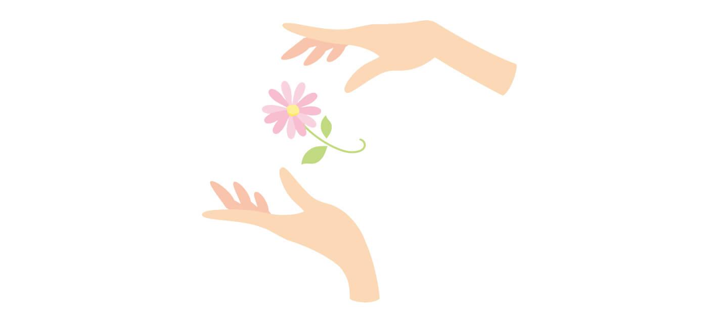 お花を大事にケアする若い女性の手